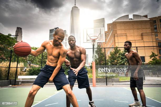 friends playing basketball in nyc