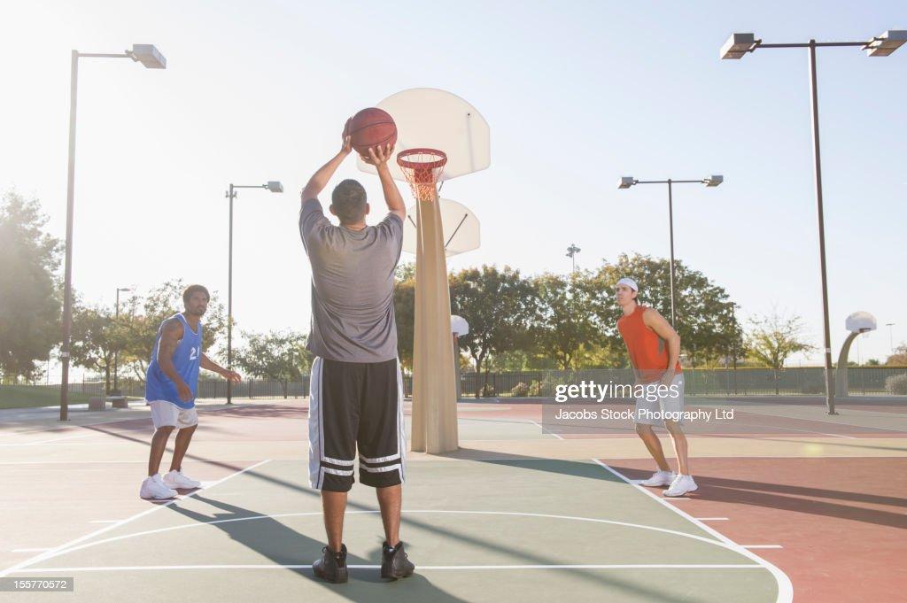 Friends playing basketball : Stock Photo