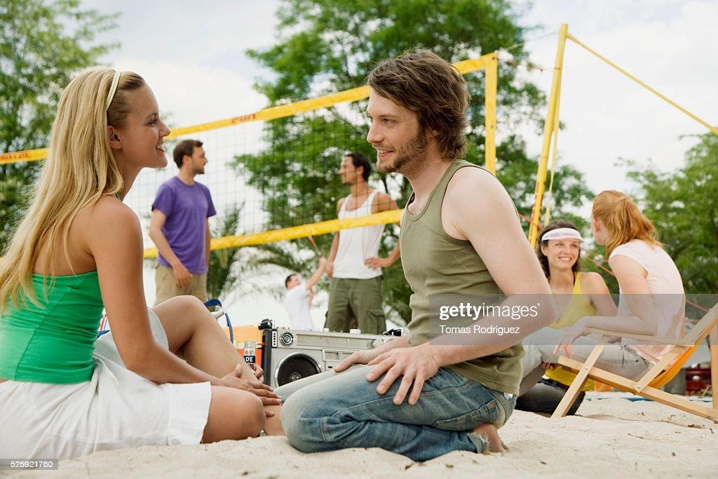 Friends Playing Beach Volleyball : ストックフォト