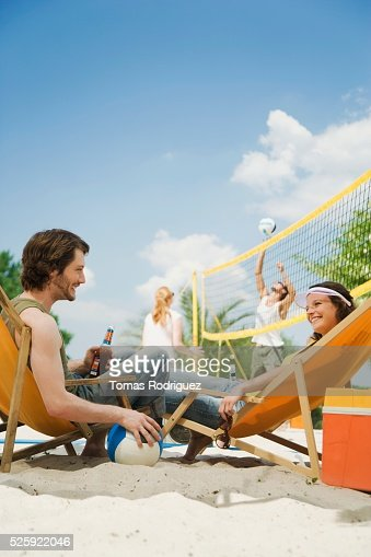Friends Playing Beach Volleyball : Stockfoto