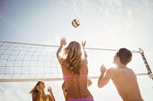 Friends playing beach volleyball on the beach