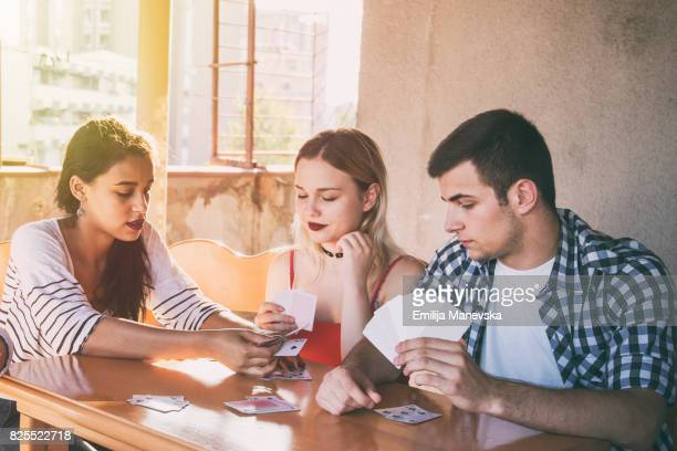 Friends playing card games