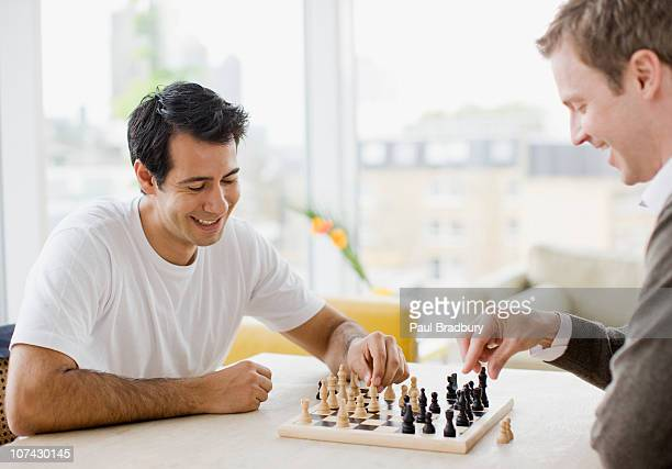 Friends playing chess together