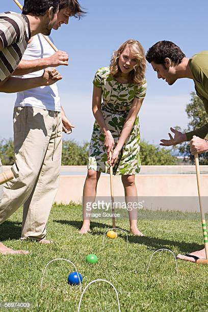 Friends playing croquet