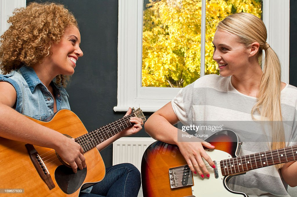Friends playing guitar : Stock Photo