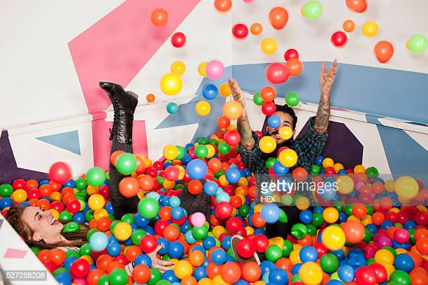 Friends playing in a ball pit
