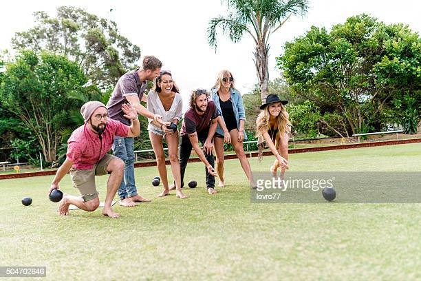 Friends playing lawn bowling