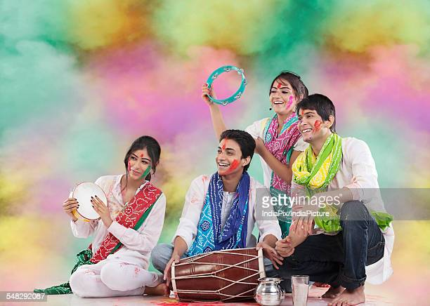 Friends playing music during holi