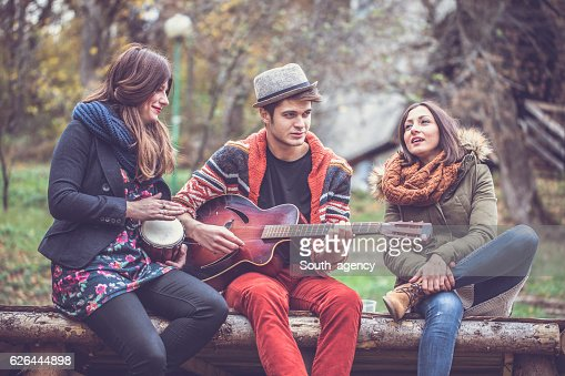 Friends playing music outdoors