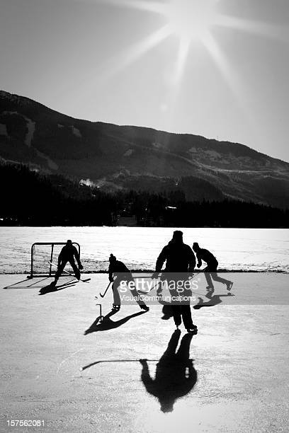 Friends playing pond hockey.