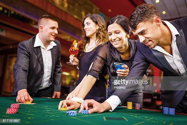 Friends playing roulette in casino