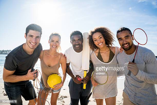 Friends playing sports at the beach