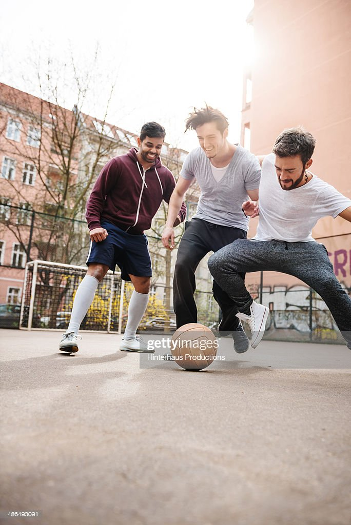 Friends Playing Urban Soccer Together