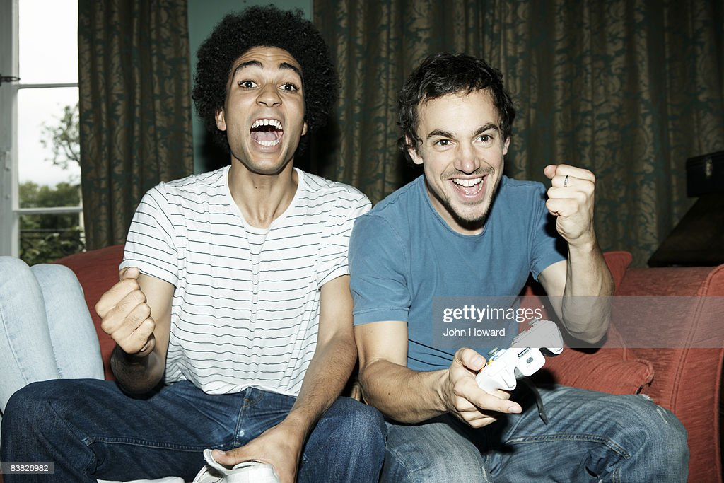 Friends playing video game : Stock Photo