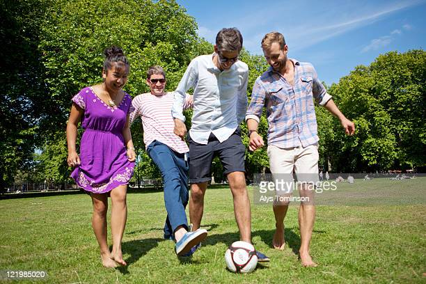 Friends Playing with a Football in a City Park