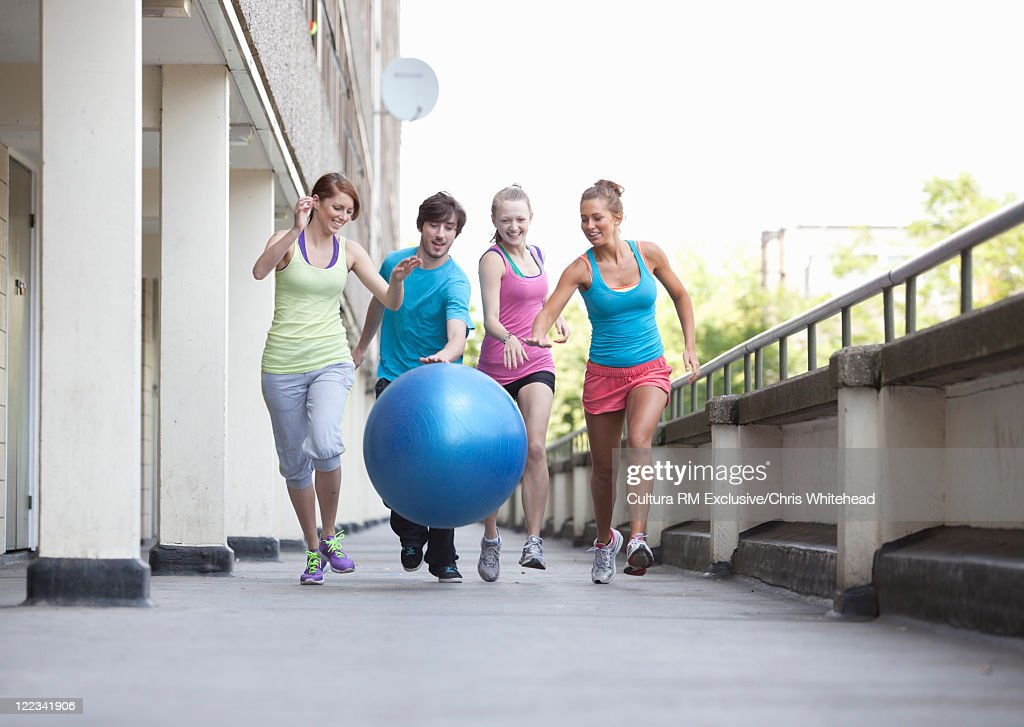 Friends playing with exercise ball : Stock Photo