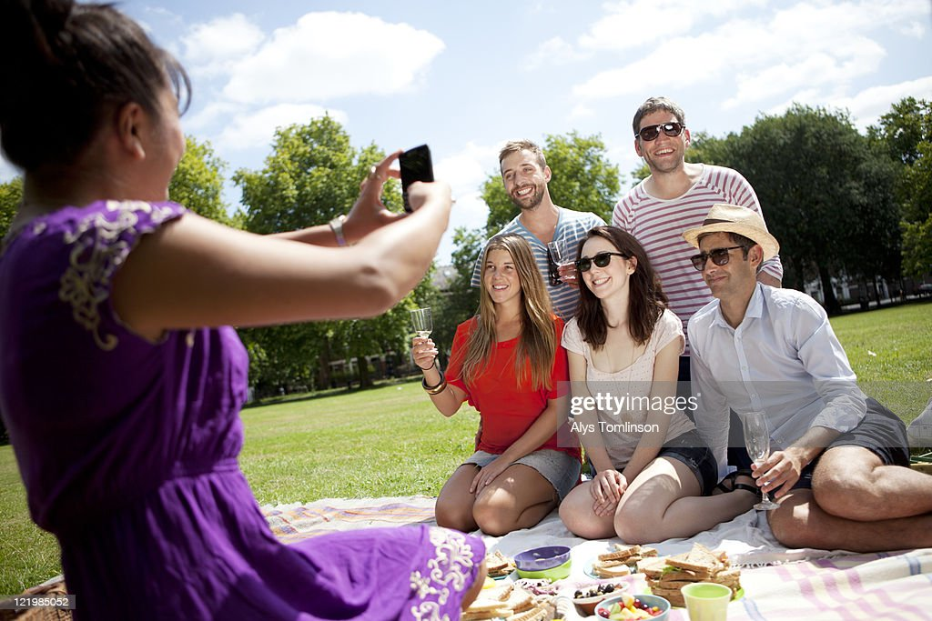 Friends Posing for a Photo in a City Park : Stock Photo