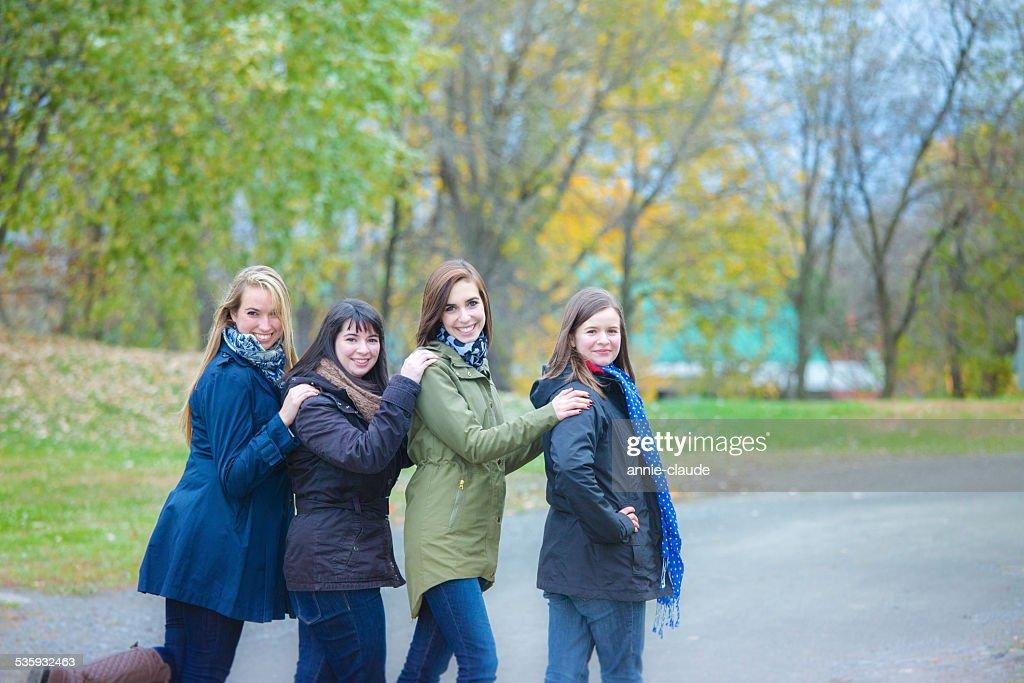 Friends posing in a fall scene : Stock Photo