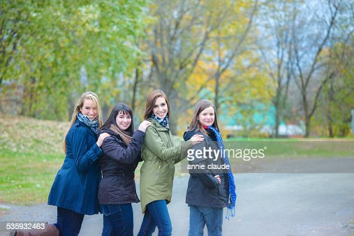 Friends posing in a fall scene : Stock Photo
