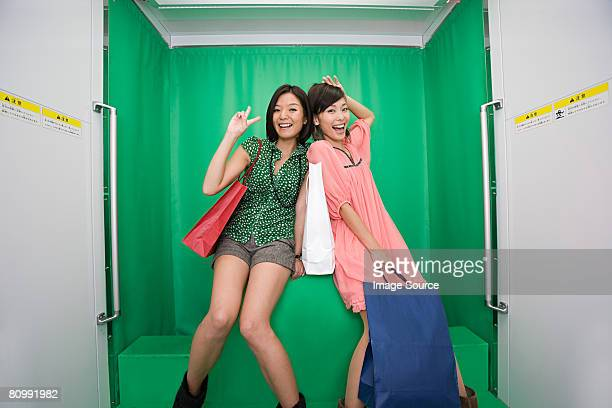 Friends posing in a photo booth