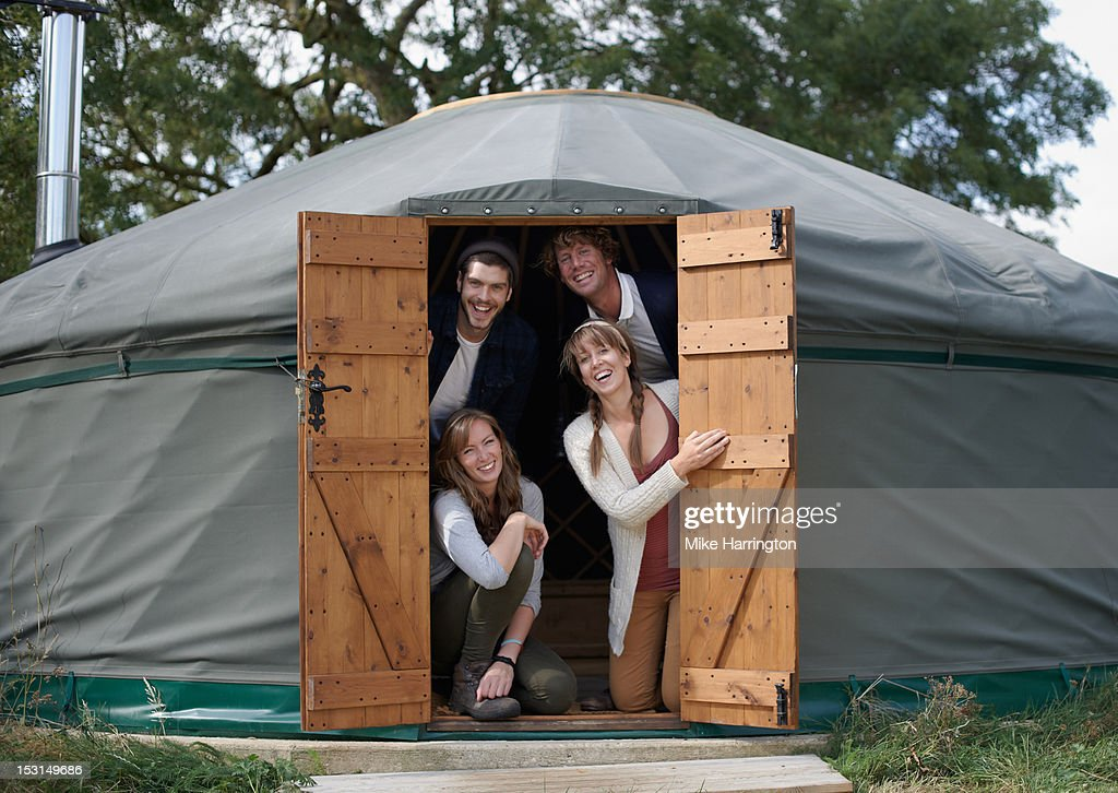 Friends posing in yurt during glamping trip. : Stock Photo
