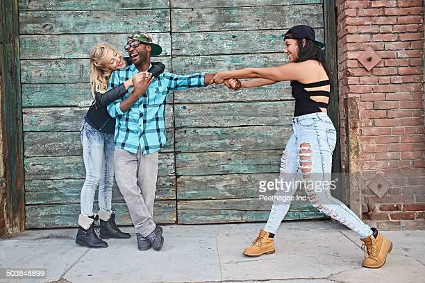 Friends posing on city street
