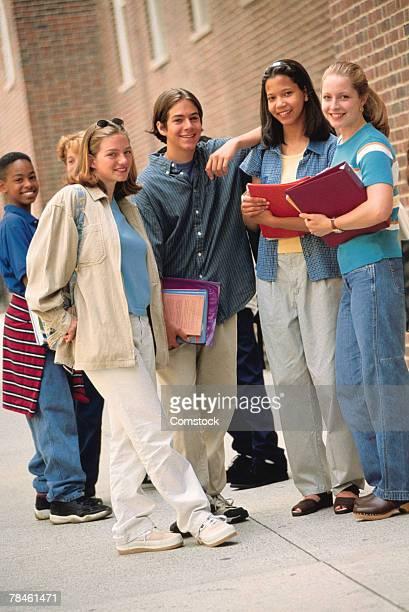 Friends posing outside school