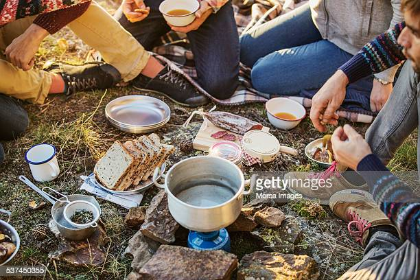 Friends preparing breakfast at campsite