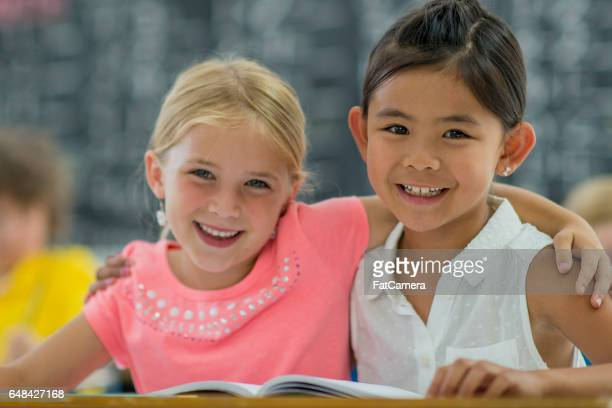 Friends Reading a Book Together
