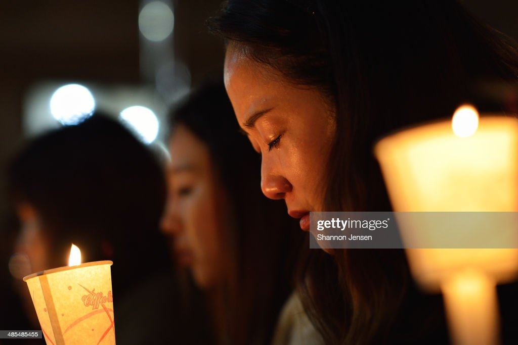 Friends, relatives and neighbors gather for a candlelight vigil at Danwon High School on April 18, 2014 in Ansan, South Korea. 325 students and 15 teachers of Danwon High School on a school trip were among the 477 passengers on board the ferry capsized off of Jindo Island in South Korea on April 16, 2014.
