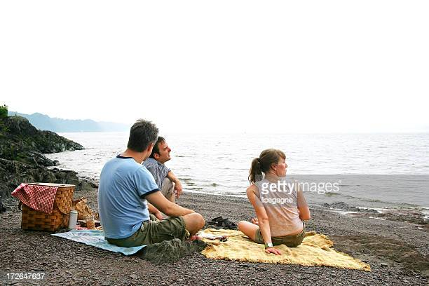 Friends relaxing by the sea