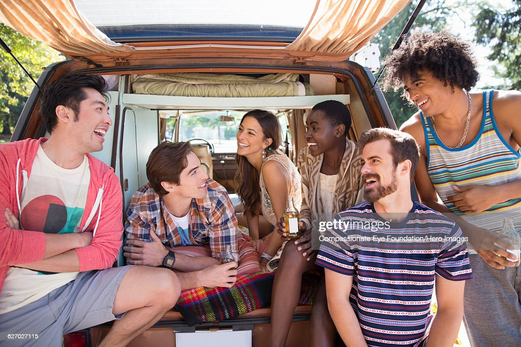 Friends relaxing in camper van : Stock Photo