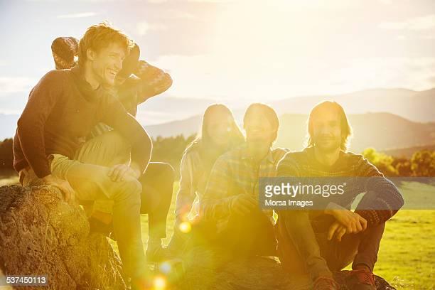 Friends relaxing on rock