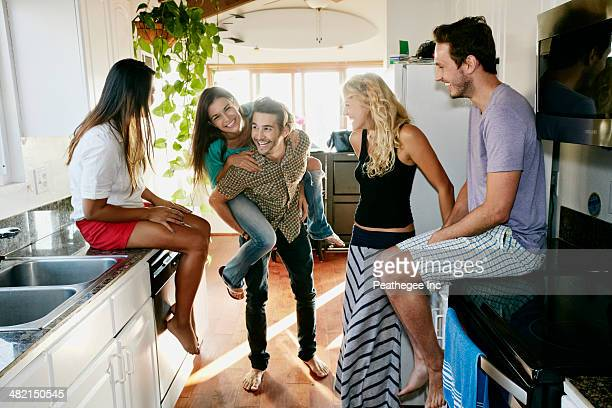 Friends relaxing together in kitchen