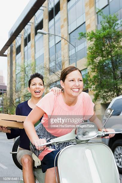 Friends riding a scooter
