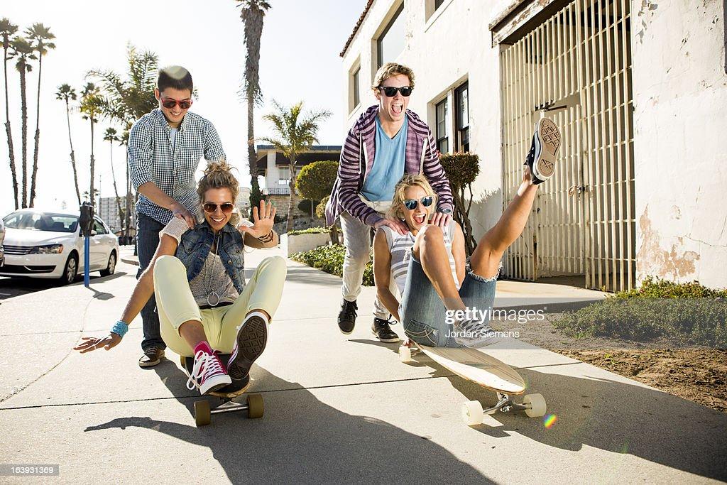 Friends riding longboards. : Stock Photo