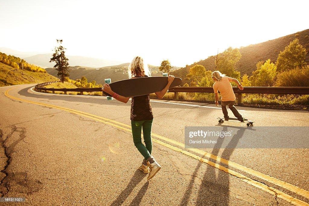 Friends riding skateboard. : Stock Photo