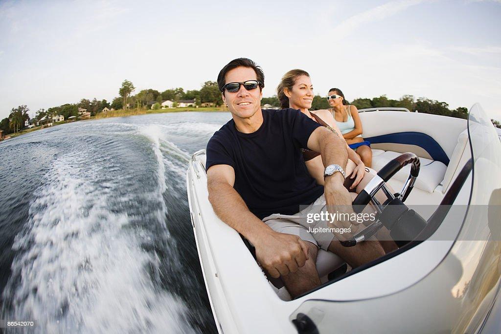 Friends riding speedboat