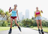 Friends rollerblading in park
