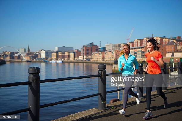 Friends Running Along the Quayside