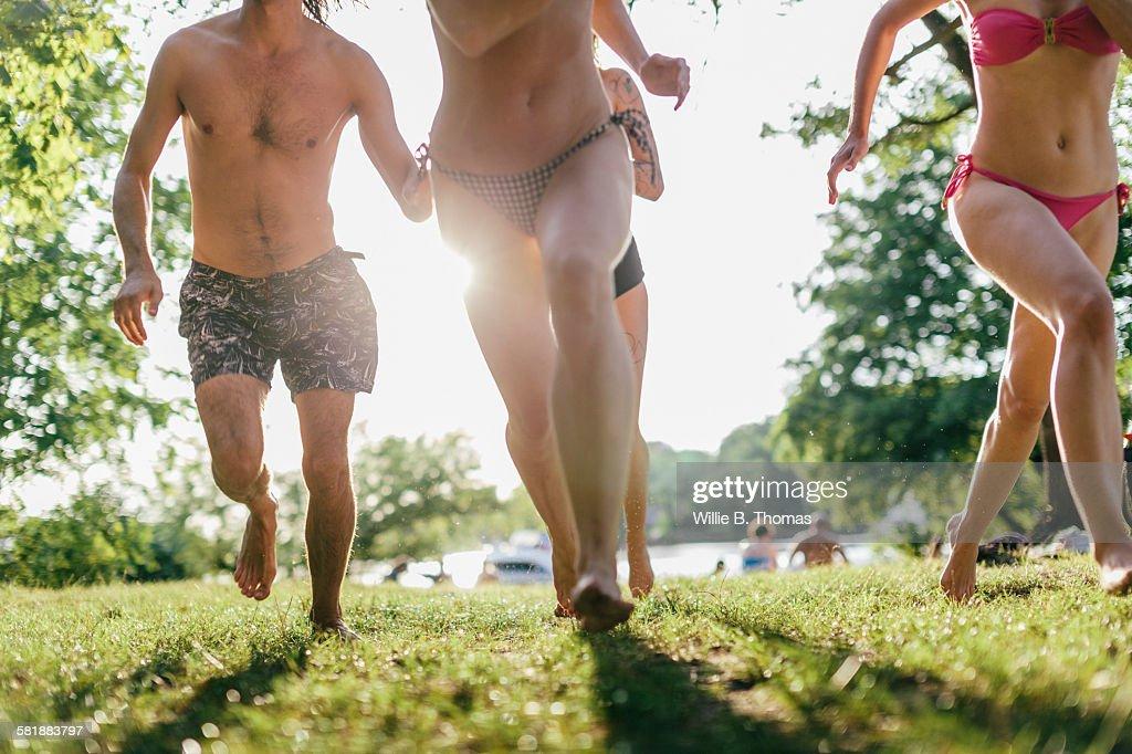 Friends running at Lake