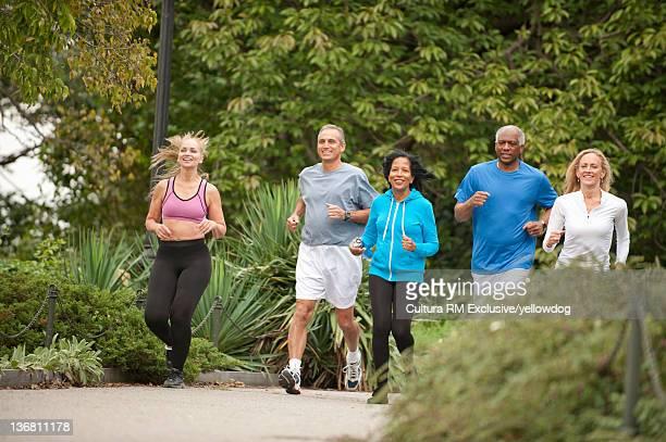 Friends running in park