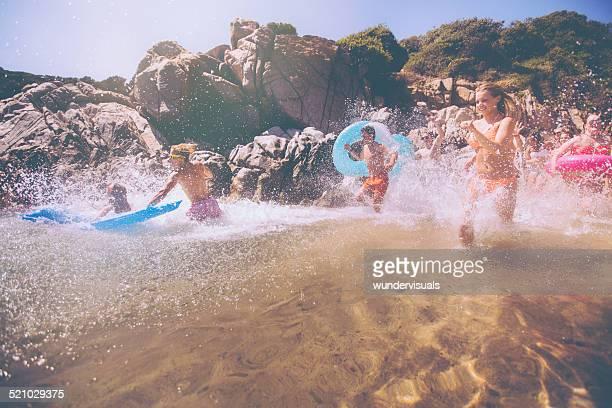 Friends Running Into Ocean