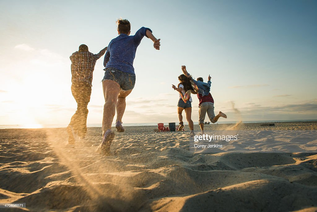 Friends running on Mission Beach, San Diego, California, USA : Stock Photo