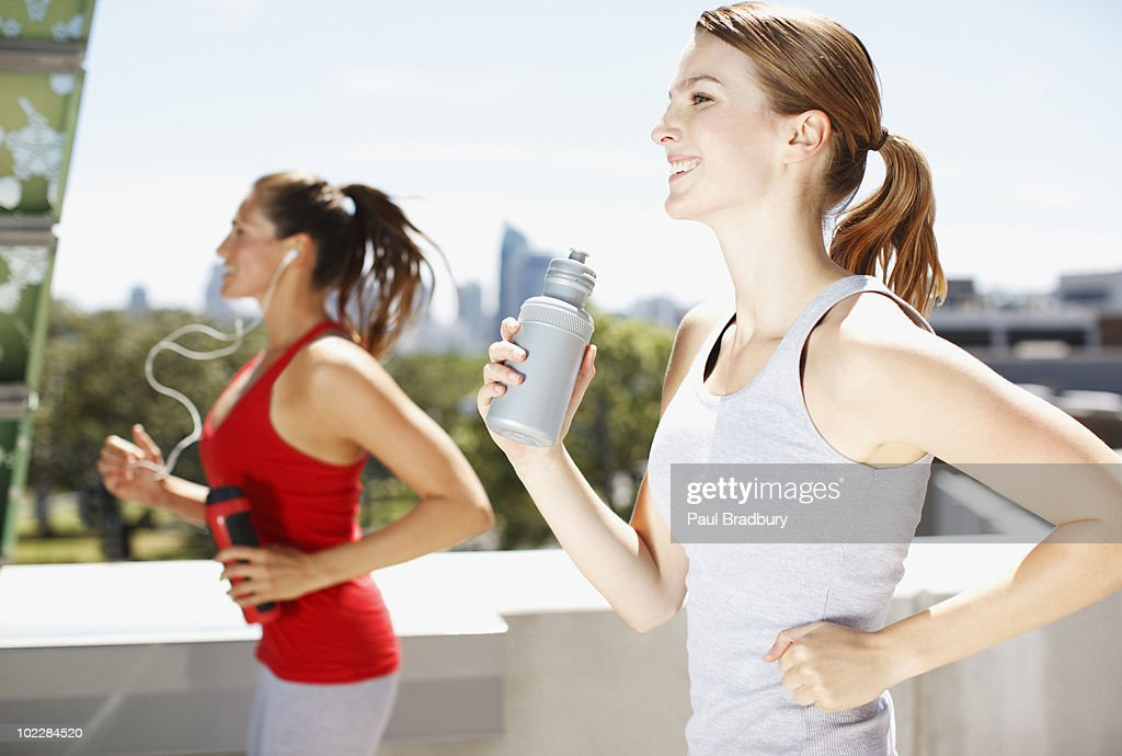 Friends running together : Stock Photo
