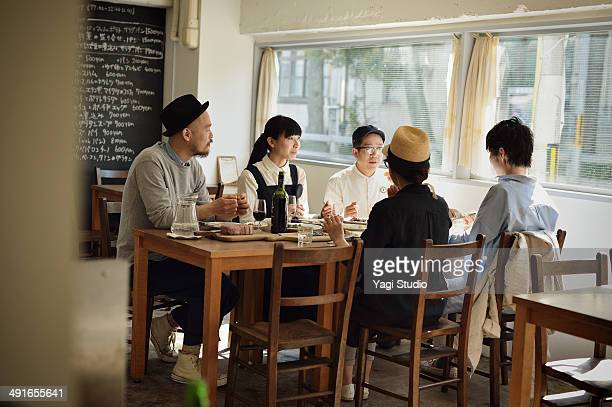 Friends sharing a meal in cafe at the early aftern