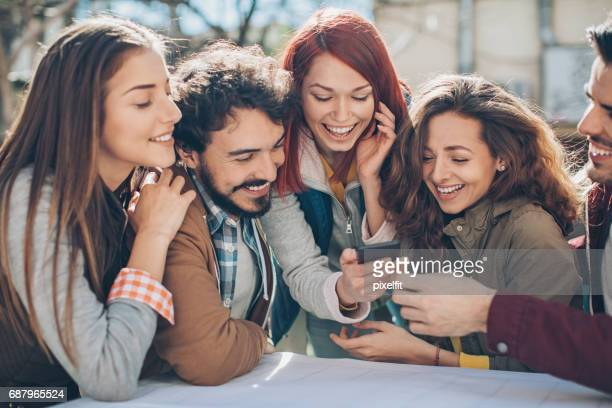 Friends sharing funny photos