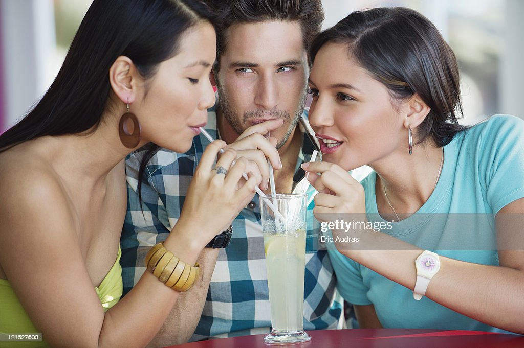 Friends sharing lime juice in a restaurant : Stock Photo