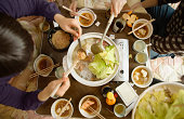 Friends sharing meal of nabemono