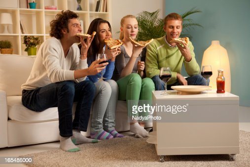Friends Sharing Pizza : Stock Photo